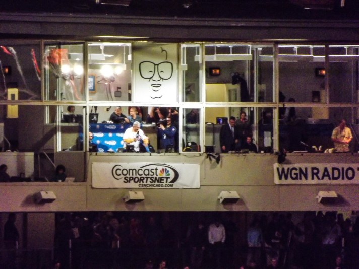 Former Chicago CBS news anchor Bill Kurtis sings during 7th inning stretch at Wrigley Field during Brewers-Cubs game.