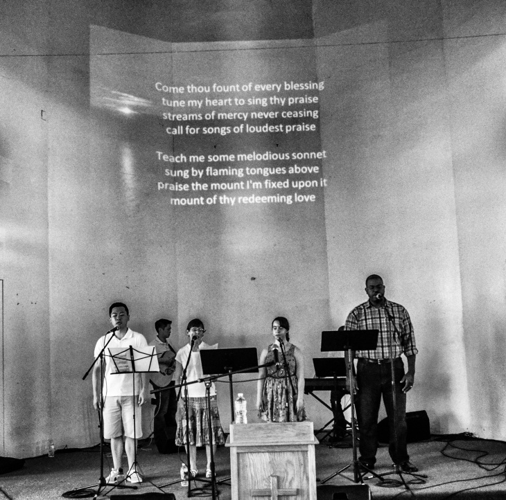 "Worship team sings ""Come thou fount of every blessing"""