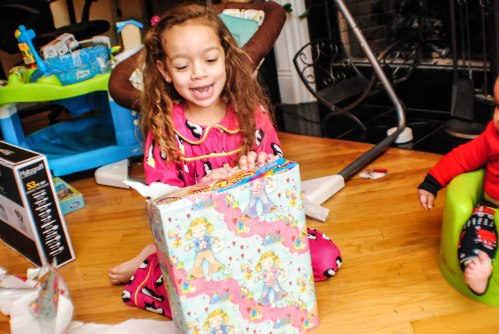 Sarah opens her first present
