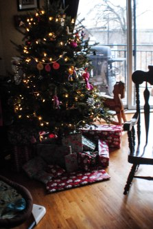 The Christmas tree full of gifts before kids get up